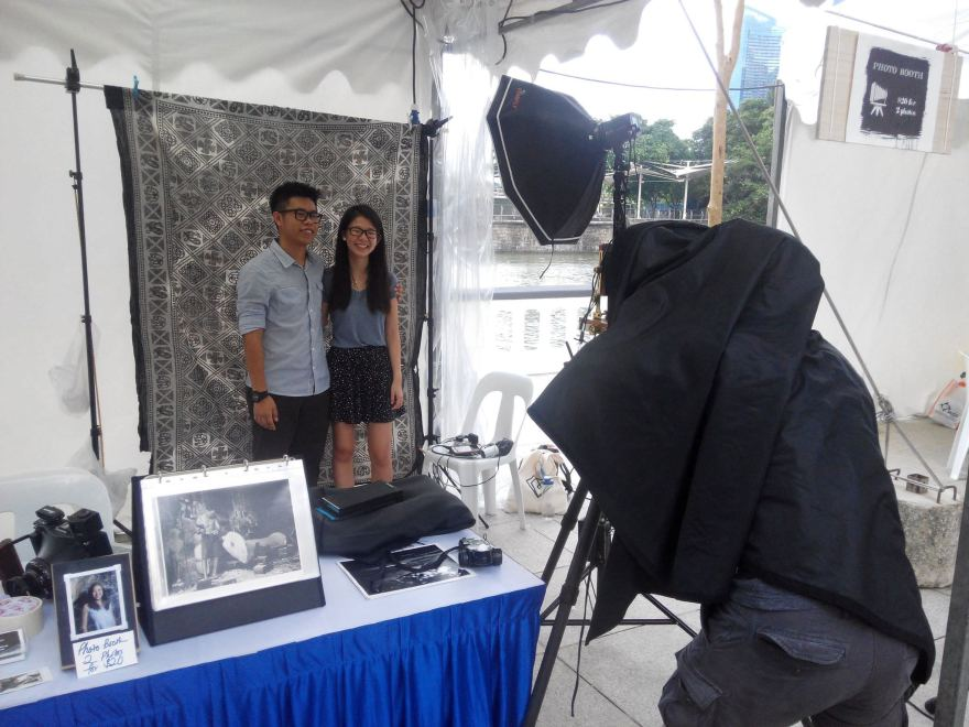 Setting up photo booth at Art Fair